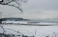 Passing Ardmore Point in the snow.<br><br>[Ewan Crawford&nbsp;//]