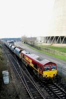 An EWS class 66 departs from Drax power station with coal empties.<br><br>[Ewan Crawford&nbsp;//]