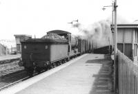 J37 0-6-0 64625 passing through Piershill Station with goods vans in 1963.<br><br>[John Robin&nbsp;31/05/1963]