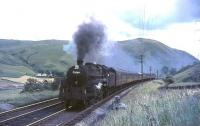 BR Standard class 5 4-6-0 73064 climbs unassisted towards Harthope viaduct in the summer of 1965.<br><br>[John Robin&nbsp;31/07/1965]