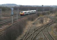 Looking south towards Carluke from Law Junction in March 2006 as a Voyager runs past the former carriage sidings.<br><br>[John Furnevel&nbsp;10/03/2006]