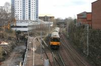 A Larkhall train leaves Hamilton Central in March 2006, running past the trap siding and onto the single line section. Work in progress alongside the line on the left will eventually provide a pedestrian link between the station and the multi storey car park on Duke Street in the centre left.<br><br>[John Furnevel&nbsp;17/03/2006]