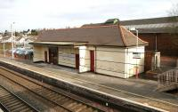 The main station building on the up platform at Carluke in March 2006, with the former goods shed beyond.<br><br>[John Furnevel&nbsp;10/03/2006]