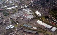 Aerial view of the former Singer Workers Platforms (centre, now the Clydebank Shopping Centre). Note trains passing to right.<br><br>[Ewan Crawford&nbsp;//]