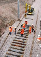 Continuing progress on the line to Larkhall in March 2005, with track laying now taking place near the site of the new Merryton station. Looking north west towards Hamilton.<br><br>[Ewan Crawford&nbsp;/03/2005]