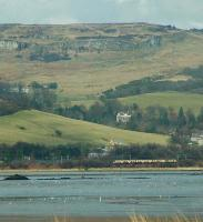 Eastbound train approaching Dumbuck with the Kilpatrick Hills behind.<br><br>[Ewan Crawford&nbsp;//]