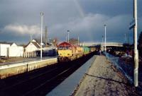 Southbound oil empties from Lairg pause at Muir of Ord for northbound passenger train.<br><br>[Ewan Crawford&nbsp;//]