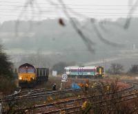 Coal train being loaded at Inverkeithing Central Junction passed by passenger train on west to south curve.<br><br>[Ewan Crawford&nbsp;//]