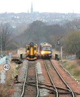 Looking west at the Edinburgh skyline as trains diverted over the sub meet on the bridge across Duddingston Park South road on Sunday 2 April 2006. Niddrie West Junction is in the foreground.<br><br>[John Furnevel&nbsp;02/04/2006]