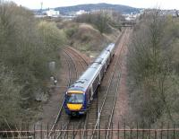 A diverted Edinburgh - Glasgow shuttle emerging from the tunnel under the Union Canal at Craiglockhart Junction on 2 April 2006 on its way to join the main line at Haymarket West Junction.<br><br>[John Furnevel&nbsp;02/04/2006]