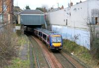 View east at Morningside Road station on 2 April 2006 with a diverted Edinburgh Waverley - Glasgow Queen Street service passing through.<br><br>[John Furnevel&nbsp;02/04/2006]