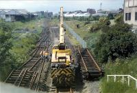 Tracklifting at Lochend Junction. The double track Abbeyhill-Lochend Junction section was being disconnected and Lochend Junction to Craigentinny Junction singled.<br><br>[Ewan Crawford&nbsp;12/06/1989]