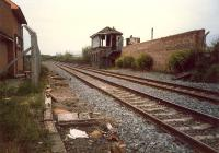 Maryhill Park Junction signalbox looking west, burned out. The equipment was moved to the building to the left but never used. Box now gone and station opened here.<br><br>[Ewan Crawford&nbsp;//1987]