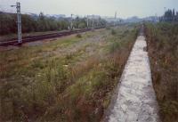 Looking east at what was Shields No 2 Junction. From left to right; the former junction between the Glasgow Central and Glasgow St Enoch routes, the wall, the former Bellahouston Carriages Sidings and the Paisley Canal Line.<br><br>[Ewan Crawford&nbsp;//1987]