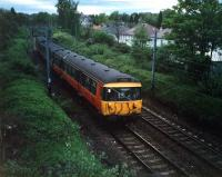 A 303 heads for Bearsden after leaving Hillfoot. This view has a lot to answer for; my grandfather used to hold me up here to see the new trains.<br><br>[Ewan Crawford&nbsp;//1987]