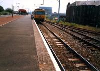 Westbound train at Dumbarton East. The loop track and line off to the right have been lifted.<br><br>[Ewan Crawford&nbsp;//1987]