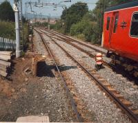 Eastbound train entering Westerton. Note the platforms have just been cut back by a few metres. Also note the unaltered layout of the junction (altered twice since then) and the box still standing.<br><br>[Ewan Crawford&nbsp;//1987]