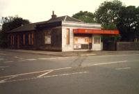 Alexandra Parade station building. Not helped by years of grime, white paint and orange canopy.<br><br>[Ewan Crawford&nbsp;//1987]