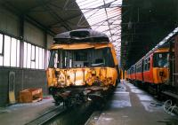 303051 badly damaged in Hyndland Depot in 1987. The EMU had been in collision with a class 37 at Dalmuir after running away. [Access by kind permission of British Rail]<br><br>[Ewan Crawford&nbsp;//1987]