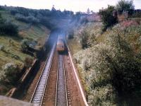 A DMU bursts smokely out of Cowlairs tunnel. The line here was crossed by a freight branch of the Caley now closed and removed.<br><br>[Ewan Crawford&nbsp;//1987]