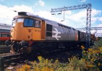 26034, tool van and crane take the dive under to join the Burma Road at Shields Junction No 1. Shields Depot behind.<br><br>[Ewan Crawford&nbsp;//1987]