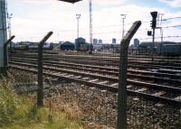 An 08 shunts the Cowlairs Carriage sidings. CGU and Sighthill Branch in foreground.<br><br>[Ewan Crawford&nbsp;//1987]