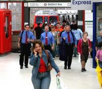 <I>'Hello.. control?....I think I've got a tail... blue shirts...red ties...mean looking gits...3 of them... could be Oyster agents....' </I>  Wimbledon District Line arrivals, July 2004.<br><br>[John Furnevel&nbsp;03/07/2004]