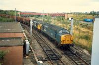 Coming off the R&C at Whifflet North Junction is a Hunterston to Ravenscraig iron ore train. In the background is the closed Whifflet Upper station, although the line was still open to Imperial Works at the time.<br><br>[Ewan Crawford&nbsp;//1987]