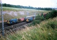 Busy little 08s shunting at the north end of Mossend Marshalling Yard.<br><br>[Ewan Crawford&nbsp;//1987]