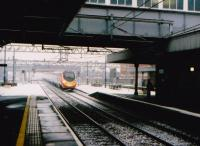 A down Pendolino approaching a lightly dusted Nuneaton just after Christmas 2005. The Pendoshorto will pass through platform 3 - platform 1, for Coventry, can be seen on the right.<br><br>[Ken Strachan /12/2005]