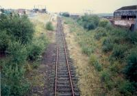 Dalmuir Riverside looking east. The bay platforms were to the left. The sidings on the right latterly served Arnott Young Shipbreakers but were originally for Beardmores Dalmuir Shipyard - the site now being a hospital.<br><br>[Ewan Crawford&nbsp;//1987]