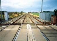 A short section of the West Coast Mainline belonged to the North British. Looking north from Heatherbell Level Crossing to Garnqueen South Junction.<br><br>[Ewan Crawford&nbsp;//1987]