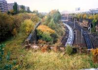 Overlooking Kinning Park Junction at Shields Road. The flyunder meets the Burma road. From left to right; Shields station (GSW, closed), Burma Road, Shields Road and Pollokshields extreme right. (Today the view is obscured by trees).<br><br>[Ewan Crawford&nbsp;//1987]