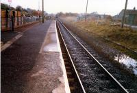 Dunlop. Remains of northbound platform on right. Carlisle train receding into distance.<br><br>[Ewan Crawford&nbsp;//1987]