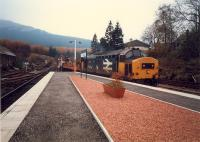 37 with permanent way train enters Crianlarich from the south.<br><br>[Ewan Crawford&nbsp;//1987]