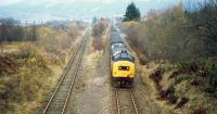 An Oban bound class 37 hauled train seen shortly after leaving Crianlarich in 1987 approaching the junction with the former Callander and Oban Railway at Crianlarich Lower Junction.<br><br>[Ewan Crawford&nbsp;//1987]