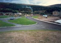 From the site of the buffers looking east at Fairlie Pier. The lines ran off to the right behind the row of houses to meet the Largs Branch.<br><br>[Ewan Crawford&nbsp;//1987]