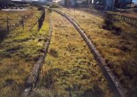 Ardrossan North from the overbridge looking to Montgomerie Pier. The trackbed to the right betrays that the Shell refinery sidings have just been lifted.<br><br>[Ewan Crawford //1987]