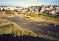 View of Ardrossan North coal yard taken, accidentally, from the same viewpoint as Geo C. OHaras 6 years earlier. The main line ran from left to the overbridge centre left. Now built on.<br><br>[Ewan Crawford&nbsp;//1987]