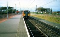 Largs-Glasgow train at Ardrossan South Beach. Eastbound platform removed.<br><br>[Ewan Crawford&nbsp;//1987]