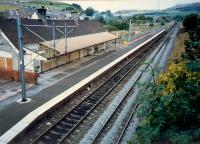 Overview of West Kilbride station looking to Largs. The very tall signalbox was located on the distant curve.<br><br>[Ewan Crawford //1987]