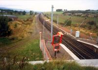 Dalry looking north. Dalry had been a large four platform station on a quadruple track section. Off to the right was the rail-served Blair Ironworks.<br><br>[Ewan Crawford&nbsp;//1987]