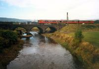 Southbound train crossing the viaduct north of Dalry station. View looks west.<br><br>[Ewan Crawford&nbsp;//1987]