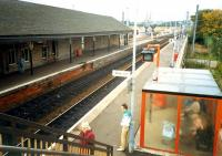 Kilwinnings Ayr platforms. The Ardrossan platforms are beyond the building to the top left. Junction on top right.<br><br>[Ewan Crawford&nbsp;//1987]