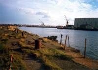 Troon Harbour looking to the land along the eastern breakwater. Ailsa Shipbuilders on right.<br><br>[Ewan Crawford&nbsp;//1987]
