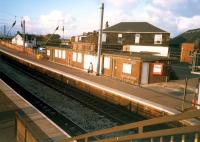 Newton-on-Ayr looking north. Unattractive and out of use building on southbound platform.<br><br>[Ewan Crawford&nbsp;//1987]