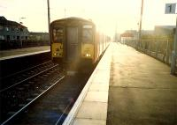 Glasgow bound, a train comes out of the sun at Stevenston.<br><br>[Ewan Crawford&nbsp;//1987]