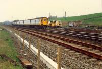 A 477 propelled train heads west at Greenhill Upper Junction.<br><br>[Ewan Crawford&nbsp;//1988]