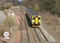 A Glasgow Central - Carlisle train north of Dumfries passing the junction with the former Port Road to Stranraer in April 2006. <br><br>[John Furnevel&nbsp;17/04/2006]