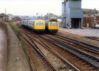 DMUs pass just north of Larbert station.<br><br>[Ewan Crawford&nbsp;//1988]